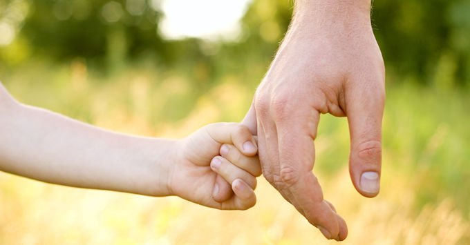 Child holding dad's hand